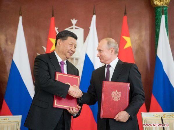 Spotkanie przywódców Chin i Rosji. Rosja Chiny złoto.